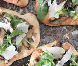 Flatbreads with Garlic Mushrooms, Parmesan and Rocket