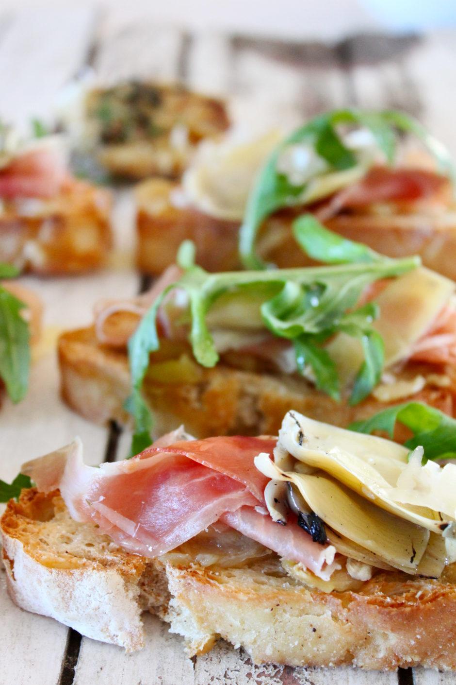Bruschetta with Squashed Roasted Garlic, Marinated Artichokes and Parma Ham