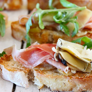 bruschetta with squashed garlic artichokes and parma ham