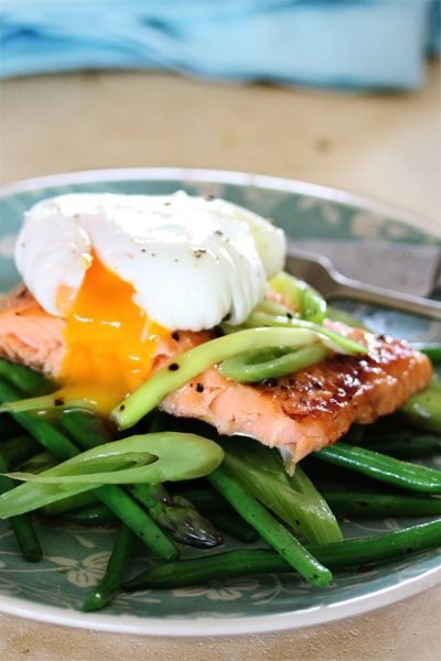 Grilled Trout on a Medley of Lemony Greens with a Soft- poached Egg