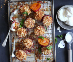 Baked Plums with spiced ginger biscuit crumble