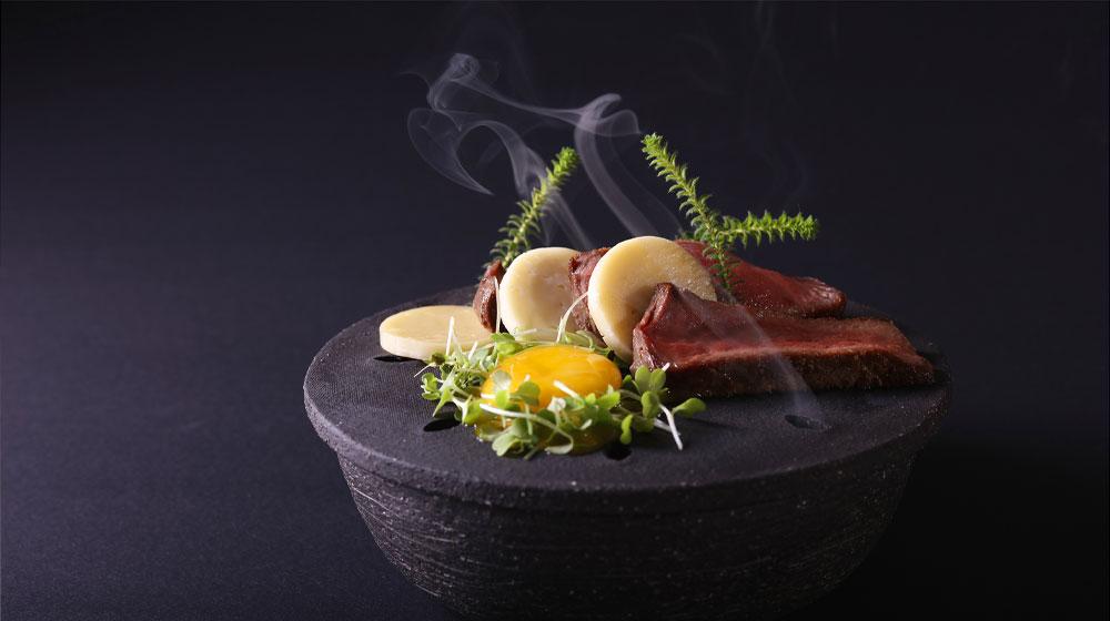Tintswalo--Atlantic--Rooibos-smoked-kudu-ocean-water-cured-egg-yolk-wild-garlic-skattie-cheese-1