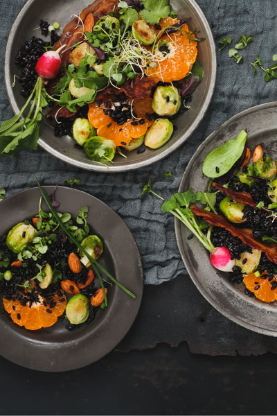 Warm Pan-Fried Brussels sprouts, Clemengold and Black Rice Salad with Crispy Bacon & Almonds