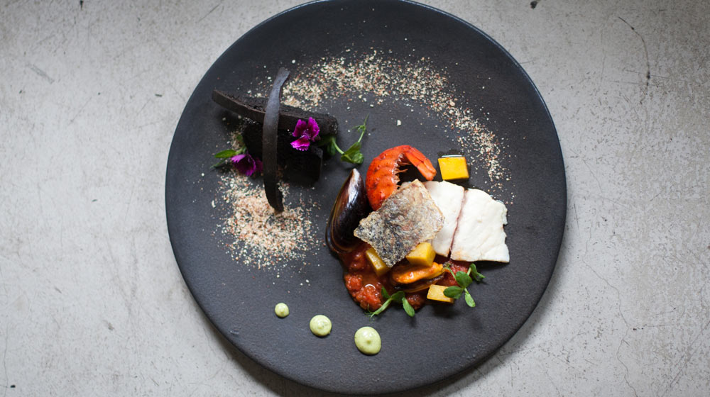 seafood poitjie with squid ink toast